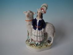 Large-Staffordshire-girl-with-oversized-sheep-figure