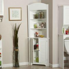 armoire d'angle blanche avec étagères de rangement ouvertes et portes volets