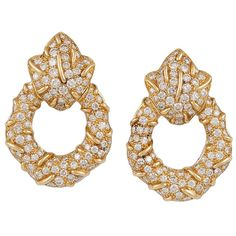 Cartier Diamond Earrings   From a unique collection of vintage modern bracelets at https://www.1stdibs.com/jewelry/bracelets/modern-bracelets/