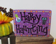 The Easter Bunny might leave some extra little special treats in your basket, and this sign reminds you to check carefully before you dig in :) This is a wooden sign, hand painted by me with bright and cheery acrylic paint, and features an embossed Easter egg to give it extra fun and holiday cheer.  THE EXACT PIECE IN THE LISTING HAS SOLD, SO YOURS WILL BE MADE TO ORDER, JUST FOR YOU :)  It measures approx. 6 inches tall by 8 inches wide, and has a sunny yellow satin ribbon attached making…