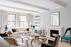 Lilly Bunn Interiors - nice carpet and split bench in front of fireplace - also like paint color and painting underside of beams