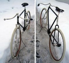 """Wow, this is a 1910 Pierce chainless, full suspension bicycle. Produced by the makers of Pierce Arrow Automobiles. Features a driveshaft instead of chain, front and rear suspension, and the most beautiful handlebars I've ever seen - """"Kelly"""" adjustable handlebars."""