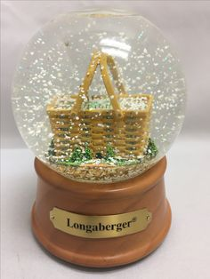 """Awesome, rare Longaberger Snow Globe with music box. Only thing I can find on it is a 2014 eBay sale that had info from Longaberger corporate (customer care department) stating """"I checked on this item with our Longaberger at Home partners. They stated the following: It may have been a prototype that we sold at Homestead, thus being a one of a kind."""" So while not a one-of-a-kind, unless this is the same one listed on eBay in 2014, it is definitely RARE. If interested, make an offer…"""