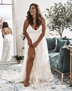 Modern brides everywhere are choosing sexy wedding dresses to wow their partner + their wedding guests. And from the high slits to the open backs to the plunging necklines, we cannot get enough of these show-stopping silhouettes that will have you look twice. So if you want to make a statement on the wedding day, you just may want to consider one of these 14 bridal gowns that are striking in all the right ways. #ruffledblog