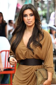 Kim Kardashian makes the most of her curves by accentuating the narrowest part of her waist with a wide belt.