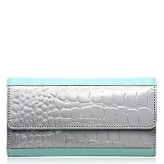 Stainless Steel wallet by Stewart/Stand: Our roomiest clutch wallet, holds all your credit cards, lots of cash, receipts, photos, check book and change. The interior change compartment keeps the exterior looking sleek... wear it out as a clutch, it's so beautiful it would be a shame to hide it. Minty jade full grain leather is brought to life as our alligator textured steel plays with shadow and light.