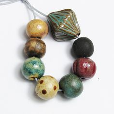 Ceramic bead bunch, handmade. I am thinking of a small kiln for this . Mine is to big and costs way to much to fire for small things.