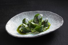 Attica Restaurant. Cucumbers, sauce of burnet, and dried river trout by chef Ben Shewry.