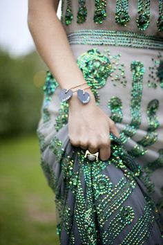 Thinking outside the strand! Gorgeous emerald bead work.