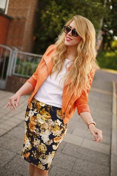 Black and orange floral pencil skirt, white top, orange blazer