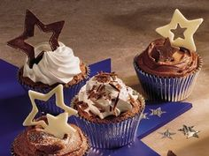 Moist, chocolaty cupcakes spread with a rich, melt-in-your mouth frosting and topped with fun chocolate designs. Yum!