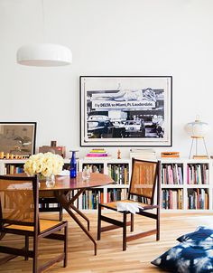 An oversize photograph by Katherine Abbey brings a retro vibe to the dining area.