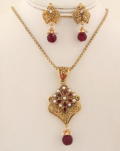 Antique gold plated necklace with Imitation pearl and Red stones-0012ATQP  http://www.craftandjewel.com/servlet/the-1201/Antique-gold-plated-necklace/Detail