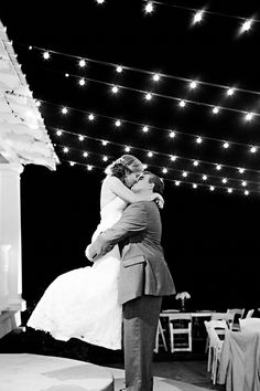 Lindsey + Carter underneath the cafe lights during their reception at The Sonnet House | Photo by Ann Wade Photography #alabamaweddings #thesonnethouse #southernweddings