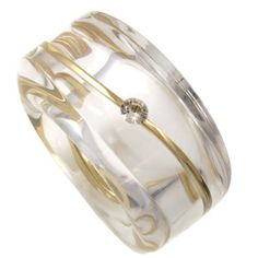 diamond suspended in clear resin band with yellow gold wavy band - situ