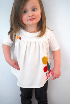 Remember the love is in the air top? I shared the applique tricks the other day for a guest post on icandy. Now today I thought I would share the top. Easy top with a sweet gather along a yoke. Start with a basic pattern for a tee. (need help drafting? Check this post)For the …