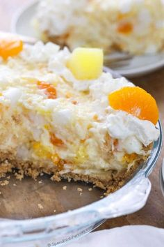 This pretty Ambrosia Pie has all of the goodness of Ambrosia Salad, tucked into a tasty graham cracker crust to be served for dessert with just a couple of minutes of prep!