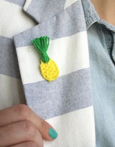 Make your own mini Crochet Pineapple pins or earrings! All you need is embroidery floss, a tiny hook, and my free pattern.