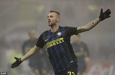 Inter Milan's Marcelo Brozovic celebrates after scoring the opening goal against Genoa