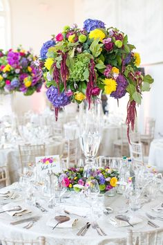 Floral table decorations. Click on the image to see our full gallery of wedding table decorations and centrepieces.
