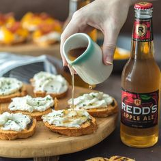 WHIPPED GOAT CHEESE CROSTINI made with an apple ale reduction is the perfect easy appetizer for any occasion. SO simple but so much flavor!!