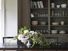 Look how beautifully these trailing honeysuckle vines spill out of the arrangement on to the table.