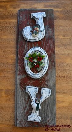 Make a creative DIY rustic Christmas sign out of some inexpensive wood letters, old jewelry and a weathered piece of wood.