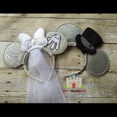 Bachelor and Bachelorette Party, Bride and Groom Mouse Ears in Glitter Vinyl. One ear Minnies hand is showing off her big Ring and the Other Ear has her Name. Top Hat can be done in Black or White. Ideal for celebrating your Bachelorette Party or having a Disney Wedding. Great photo