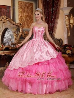 Brand New Rose Pink Quinceanera Dress Sweetheart Taffeta and Oragnza Embroidery Ball Gown  http://www.fashionos.com  Luxurious and Romantic- This ball gown features a sweetheart neckline accented with appliques at the fitted bodice. The decorative pattern make the dress elegant and distinctive. The puffy skirt creates a beautiful shape to complete the dress.