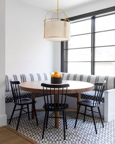 dining room 156007574578698384 - A white drum cage pendant hangs over an oval wood dining table placed on white and black mosaic floor tiles and seating two black Windsor dining chairs facing a white l-shaped dining banquette. Source by knatschinats Room Tiles Design, Dining Room Design, Dining Decor, New Kitchen, Kitchen Decor, Kitchen Design, Awesome Kitchen, Windsor Dining Chairs, Kitchen Benches