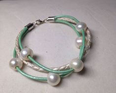 A personal favorite from my Etsy shop https://www.etsy.com/listing/237735420/freshwater-pearl-seafoam-green-and