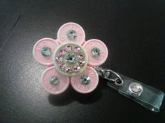 Green Pink Flower ID Badge Holder - made from medicine vial caps :). $6.50, via Etsy. Id Badge Holders, Id Holder, Badge Reel, Diy Arts And Crafts, Diy Craft Projects, Fun Crafts, Nurse Crafts, Badge Maker, Work Badge