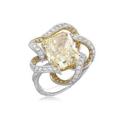 http://www.NiravModi.com/ #Ring featuring a fancy yellow radiant-cut #Solitaire, surrounded by a delicate ribbon of fancy yellow and white diamonds, as featured in 'Essence of a Bride'.