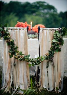 such a romantic garland, strung between the mr and mrs chairs