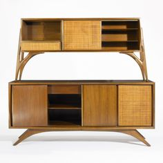 Vladimir Kagan; Walnut, Cane and Brass Cabinets for Grosfield House, c1952.