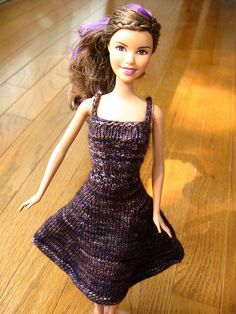 Knitted Barbie dress by quirky granola girl with link to website with over 1000 free Barbie knit clothing patterns!