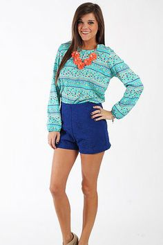 The Sasha Shorts, Royal Blue $42.00 How cute are these shorts?! The high waisted style is going to be big again this season, and we love the embossed feel of the floral details on these shorts. Tuck a tank in or wear a top out, you can do so many things with these shorts!   Fits true to size. Miranda is wearing a small.