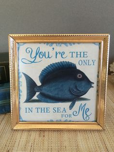 Youre the only fish in the sea | Fish Art | Blue Fish | Coastal Decor | Beach Decor | Coastal Art | Beach Art This sweet vintage blue fish art was created using vintage art, handpainted art, and adding words in Photoshop to create a unique coastal print. The print is new and was made on high quality inkjet paper. The printed artwork has been added to a vintage goldtone frame. Makes a great gift! Dimensions: 5 1/8 square  Your item will come tastefully packaged with some Florida seashells...