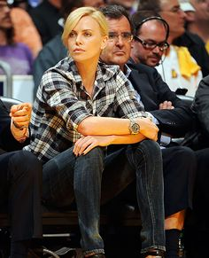 Charlize Theron in her Men's Rolex Oyster Perpetual Sea-Dweller Submariner