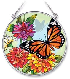 Amia 5683 Medium Circle Suncatcher with Butterfly Design by Amia. $14.26. 4-1/2-inch circle. Hand-painted glass. Includes chain. Nature lovers will be attracted to this Amia suncatcher, designed by artist Sandy Clough featuring a Monarch butterfly in a garden of colorful flowers.. Save 11% Off!