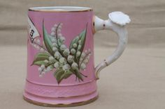 antique china mustache cup, Victorian era mug w/ lily of the valley on pink Lily Of The Valley Bouquet, Etiquette Vintage, Laurel Leaves, Rose Of Sharon, Ice Sculptures, Antique China, Victorian Era, Cup And Saucer, Planting Flowers