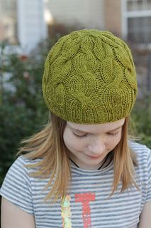 this beginner-friendly cabled hat is knit from the bottom up, starting with a rib band and working into alternating cables that decrease into the crown.