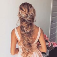 Wedding hair!! Flowers braided into hair.  Then pulled for a messy effect!! GORGEOUS!