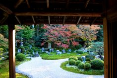 """Karesansui Garden in Ryōan-ji Temple, Japan.  it is a Japanese rock garden (枯山水) or """"dry landscape"""" garden, often called a zen garden, creates a miniature stylised landscape through carefully composed arrangements of rocks, water features, moss, pruned trees and bushes, and uses gravel or sand that is raked to represent ripples in water."""