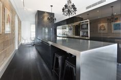 Modern kitchen, stainless steel benchtop, black kitchen