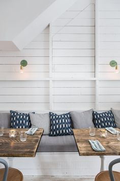 white table base, wood tables, banquettes and wall lights. this is a muse for me!