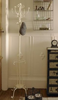 Cream coat and hat stand