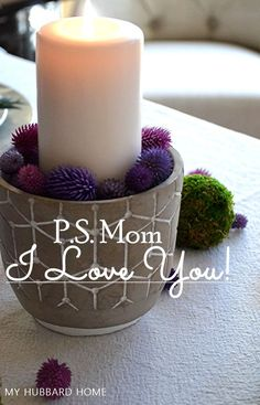Want to make mom feel special? Then set a pretty P.S Mom I Love You - A Mother's Day Tablescape using some simple tips that will make the day memorable. Use Purple Globe Amaranth and Moss Balls to create this awesome tablescape! #Mother'sdaytablescape #Springtable #Flowerarrangements  #WhiteDishes #Brunchtable #Myhubbardhome.com