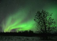 The Aurora Borealis, commonly known as the Northern Lights, is a natural light display caused by charged solar particles colliding with the Earth's atmosphere. Description from abc2news.com. I searched for this on bing.com/images