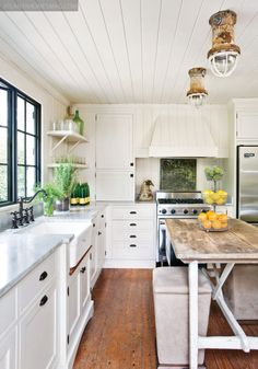 White kitchen, wood floor, white shelves, and that citrus island bench centerpiece is a pop of simple happy brilliance!